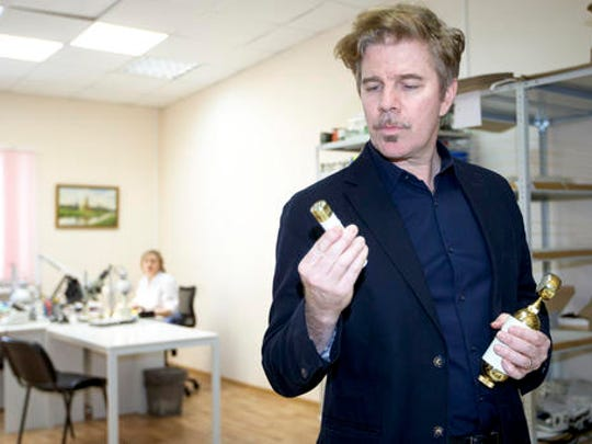 On this Thursday, Feb. 9, 2017 photo Californian musician David Brown inspects a microphone at a factory in Tula, Russia. Brown and fan Pavel Bazdyrev are a rare example of success in Russia's consumer goods industry. They have been making high-end microphones in Russia since 2014, taking advantage of cheap labor and second hand machinery from Kalashnikov arms plants.