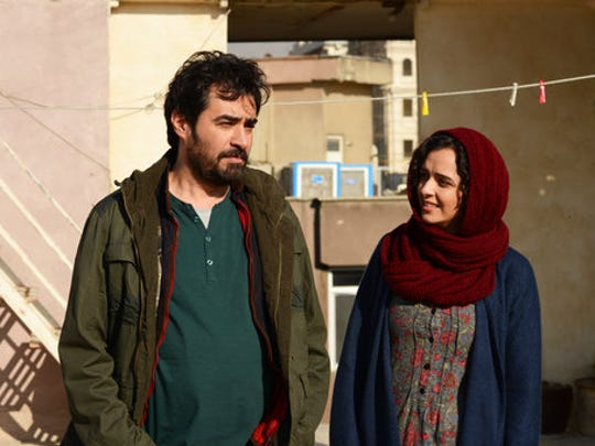 """This image released by Cohen Media group shows Shahab Hosseini, left, and Taraneh Alidoosti in a scene from """"The Salesman."""" The film won an Oscar for best foreign language film at the 89th Academy Awards on Feb. 26. Movie theaters nationwide are programming with politics in mind.  In May, a coalition has formed to play films from the predominantly Muslim countries targeted by Donald Trump's travel ban."""