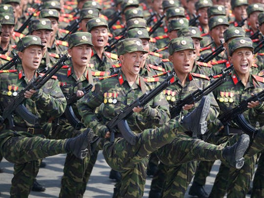 FILE - In this April 15, 2017, file photo, soldiers march across Kim Il Sung Square during a military parade in Pyongyang, North Korea, to celebrate the 105th birth anniversary of Kim Il Sung, the country's late founder and grandfather of current ruler Kim Jong Un. North Korean fury at Washington was rising well before U.S. President Donald Trump took office, in particular over reports that annual U.S.-South Korean military exercises now include training for precision strikes on the North's leadership or nuclear and military facilities.