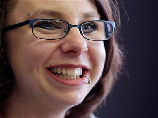 In this June 2014, the former Michelle Knight smiles during an interview in Cleveland. Now using the name Lily Rose Lee, she was one of three women held captive in a Cleveland home for about a decade. (AP Photo)