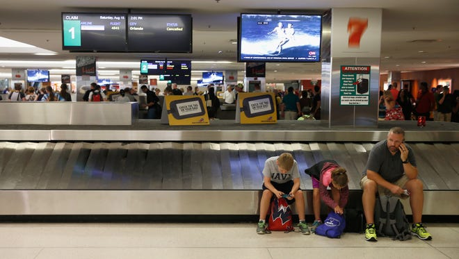 Passengers wait for luggage at the Southwest Airlines baggage claim at Baltimore/Washington International Airport on Aug. 15, 2015.