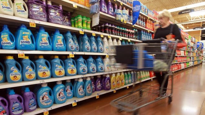 A Kroger customer shops in the laundry detergent aisle.