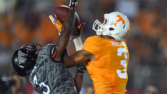 Vols receiver Josh Malone (3) catches a touchdown pass while being defended by Virginia Tech defensive back Greg Stroman (3) during the first half on Sept. 10, 2016.