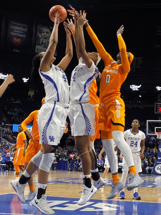 Tennessee's Rennia Davis (0) battles for a rebound against Kentucky's Alyssa Rice, left, and Tatyana Wyatt during an NCAA college basketball game in Lexington, Ky., Sunday, Dec. 31, 2017. (AP Photo/Matt Goins)