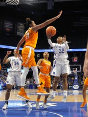 Tennessee's Merecdes Russell, front left, blocks a shot by Kentucky's Jaida Roper during an NCAA college basketball game in Lexington, Ky., Sunday, Dec. 31, 2017. (AP Photo/Matt Goins)