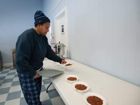 Toni Short, a site manager at Immanuel Shelter near Rehoboth, sets out bowls of chili for lunch.