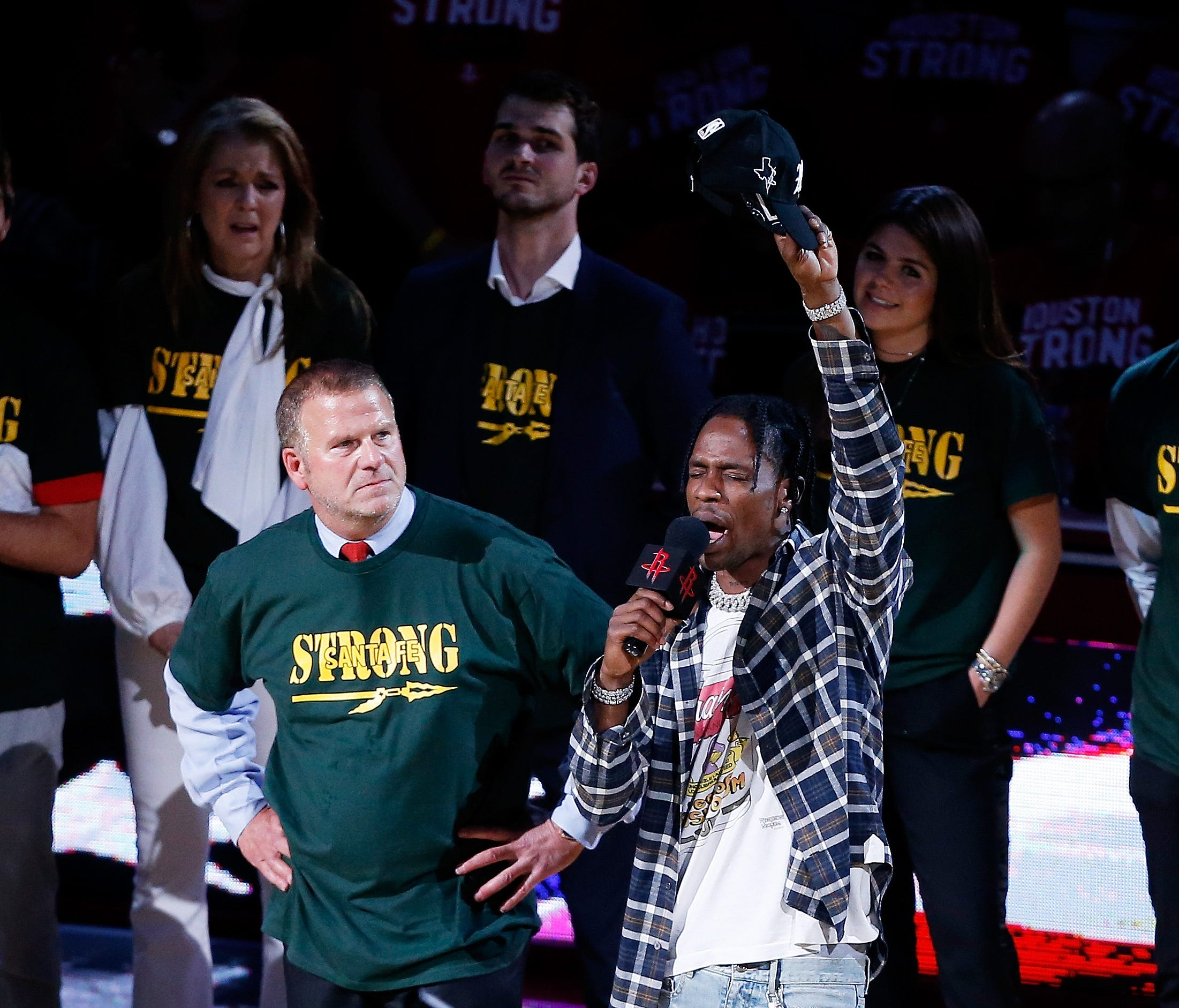 Houston Rockets pwner Tilman Fertitta and rapper Travis Scott speak as part of a tribute to honor the victims of the May 18th shooting at Santa Fe High School.