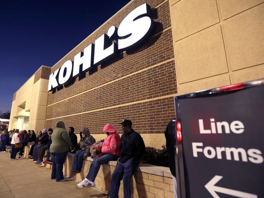 A line of Thanksgiving shoppers forms at the entrance