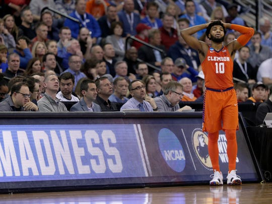 Clemson's Gabe DeVoe pauses during the second half of a regional semifinal game against Kansas in the NCAA men's college basketball tournament Friday, March 23, 2018, in Omaha, Neb. (AP Photo/Nati Harnik)