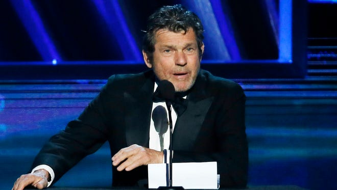 "FILE - In this April 18, 2013 file photo, Rock and Roll Hall of Fame chairman, and ""Rolling Stone"" magazine editor and publisher, Jann Wenner, speaks during the Rock and Roll Hall of Fame Induction Ceremony in Los Angeles. Wenner, who founded the magazine as a 20-year-old college dropout, is weathering the stiffest test of Rolling Stone's credibility that the magazine has faced in its 48-year history. On Sunday, April 5, 2015, the magazine retracted last November's story on sexual assault at the University of Virginia in advance of the release of a damning Columbia University report about its reporting and editing, and on Monday, a fraternity named in the story threatened a lawsuit. (Photo by Danny Moloshok/Invision/AP, File)"