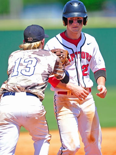 Ravenwood's Hagan Severance, right, is tagged out by Farragut third baseman Chase Fullington in Class AAA baseball tournament at Siegel High School in Murfreesboro, Tenn., Wednesday, May 19, 2014.