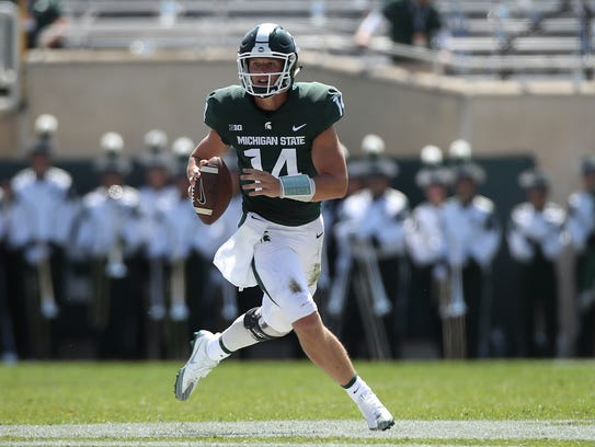 Michigan State quarterback Brian Lewerke looks for