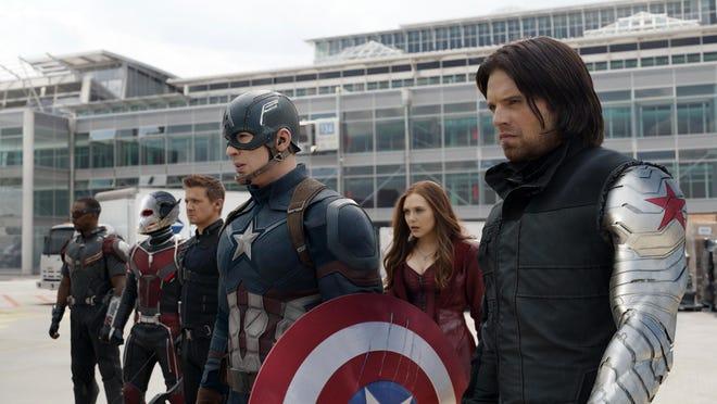 """Anthony Mackie, from left, Paul Rudd, Jeremy Renner, Chris Evans, Elizabeth Olsen and Sebastian Stan appear in """"Captain America: Civil War."""""""