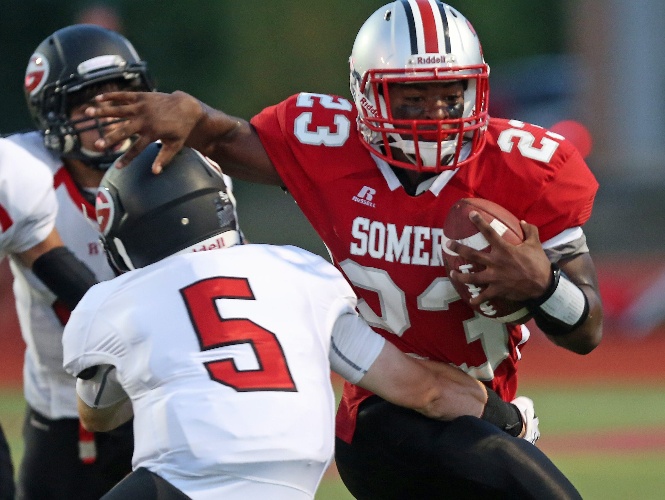 Somers's Messiah Horne (23 ) tries to get around Rye's Tyler Reno (5) during first half action at Somers High School Sept. 4, 2015