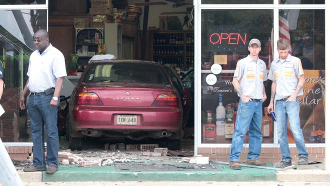 A two-vehicle accident on Louisville Avenue sends a car crashing through the front of Tonores Wine Cellar on April 15.