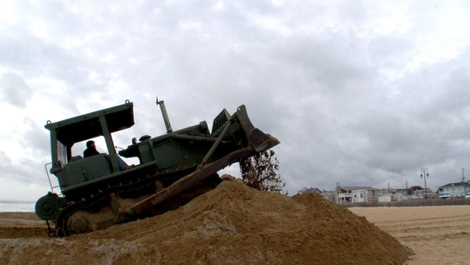 Joe Daniel operates a bulldozer as the Belmar Public Works Department builds dunes along the coastline Wednesday in anticipation of Hurricane Joaquin hitting this weekend. Major coastal flooding also is possible Friday and Saturday.