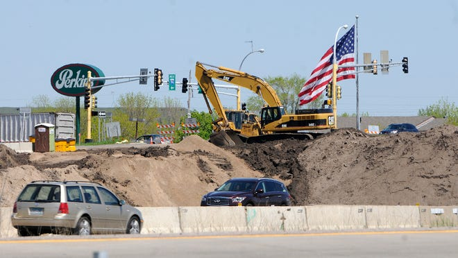 Equipment is staged near the U.S. Interstate Highway 94 westbound ramp from Highway 25 in Monticello Friday.