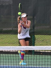 Elise Sickle returns a serve against Tori Hockaday in the championship of the Muse Cup on Saturday.