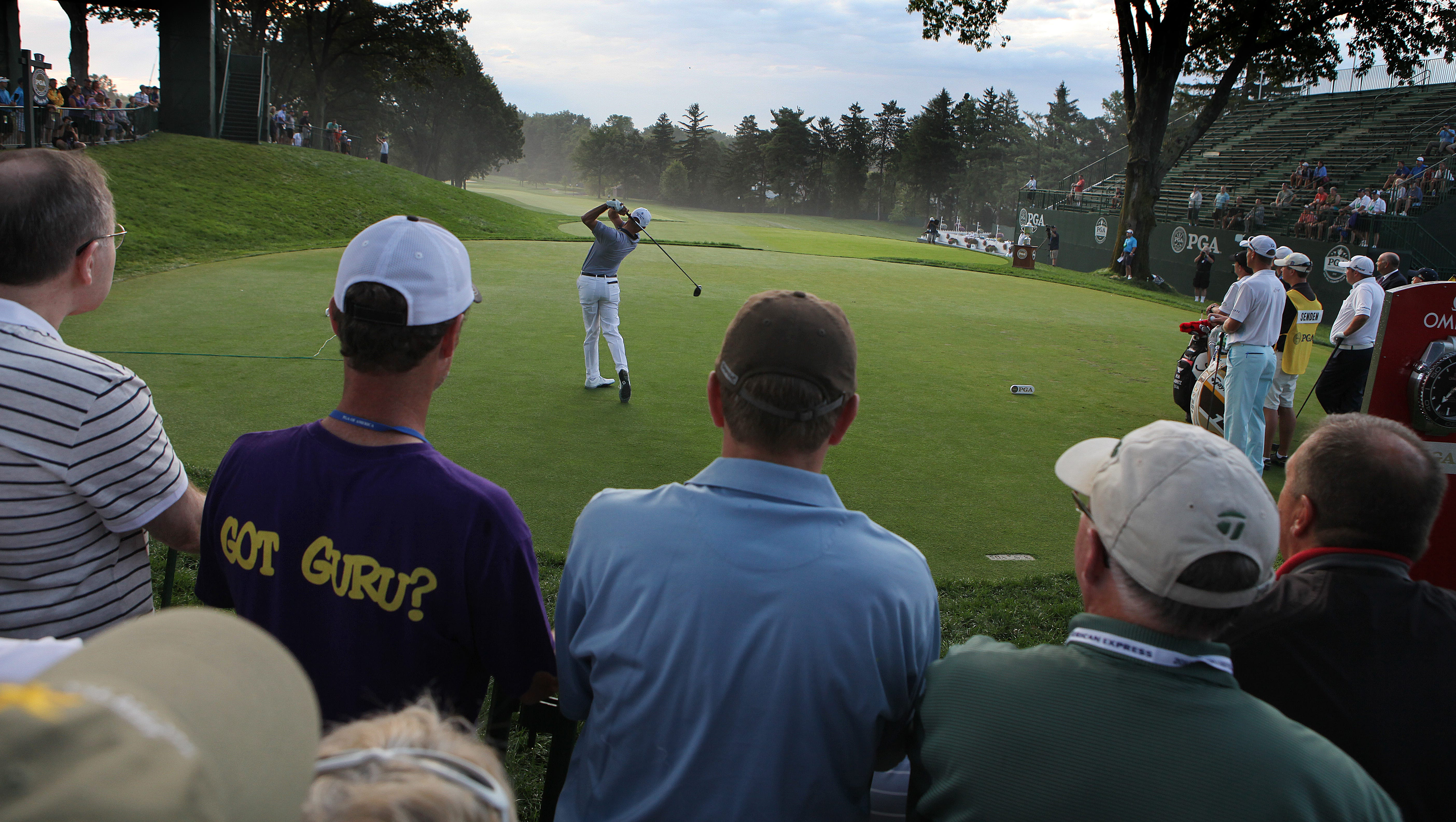 Fans watch as Rob Labritz follows the first ball off the tee during the 95th PGA Championship.