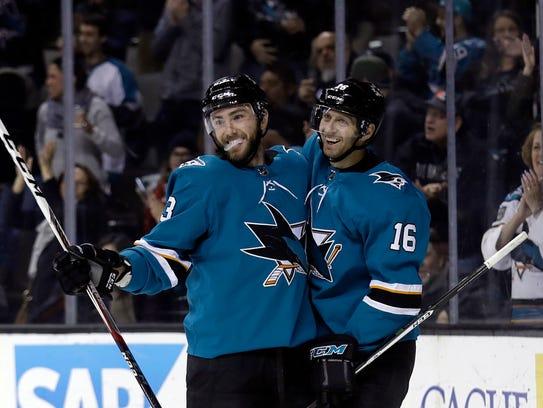 San Jose Sharks' Barclay Goodrow, left, celebrates