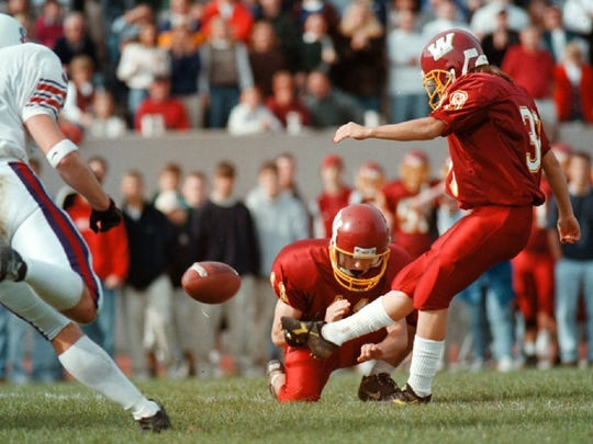 Willamette University's Liz Heaston kicks an extra point during a win over Linfield on Oct. 18, 1997, to become the first woman to play in a college football game.