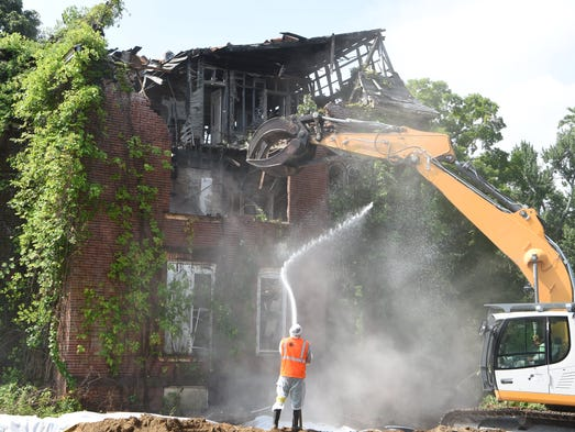 A portion of a building is torn down at the former
