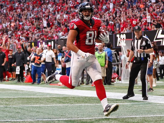 Atlanta Falcons tight end Austin Hooper (81) runs into the end zone for a touchdown against the Tampa Bay Buccaneers during the first half of an NFL football game, Sunday, Oct. 14, 2018, in Atlanta. (AP Photo/John Bazemore)