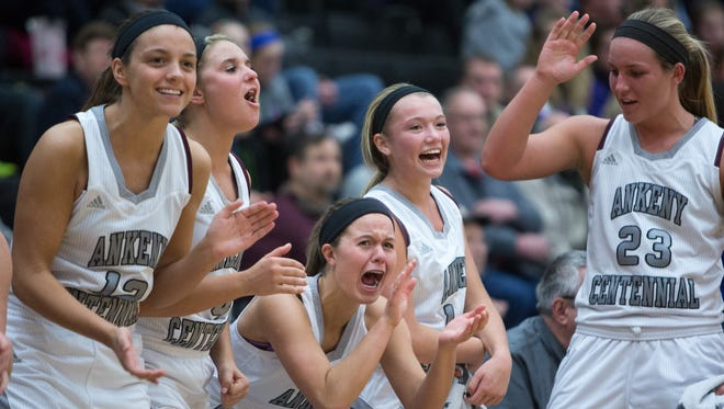 Ankeny Centennial High School players celebrate a shot on Waukee in the third quarter Friday, Feb. 6, 2015, at Ankeny Centennial in Ankeny.