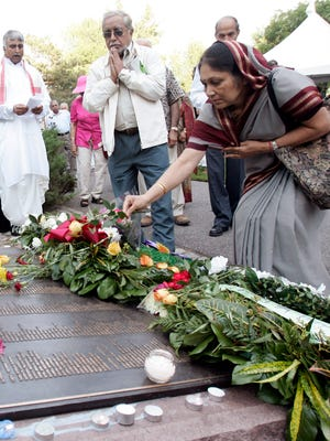 People pay their respects in 2006 at a plaque in Ottawa honoring the victims of the Air India bombing.