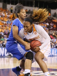 Tennessee forward Bashaara Graves (12) battles for a loose ball with Kentucky forward Jelleah Sidney (12) during the semifinals of the SEC Women's Tournament on March 7, 2015.