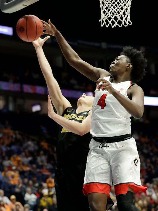 Georgia forward Caliya Robinson (4) blocks a shot by Missouri's Jordan Frericks, left, in the first half of an NCAA college basketball game at the women's Southeastern Conference tournament Friday, March 2, 2018, in Nashville, Tenn. (AP Photo/Mark Humphrey)