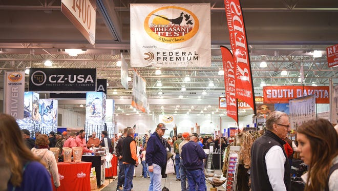 People browse the booths at the 2018 National Pheasant Fest & Quail Classic Friday, Feb. 16, at the Denny Sanford Premier Center.