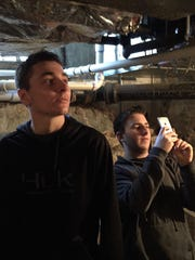 St. Georges junior HVAC students Aiden Riley, Evan Trakas, and Kyle Malice explore the HVAC system of the Historic George Reed House in Old New Castle.