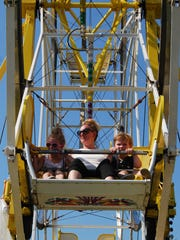 Stacey Mayea rides the Ferris wheel at the St. Mary's