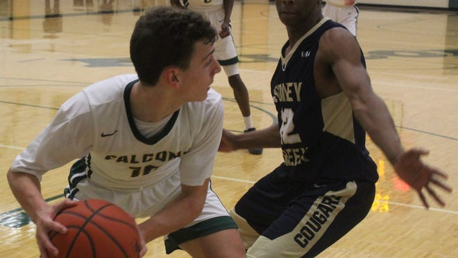 Groves senior Spencer Tredwell (11) looks to pass past Stoney Creek defender Andrew Carson (12) during Friday's OAA White Division battle.