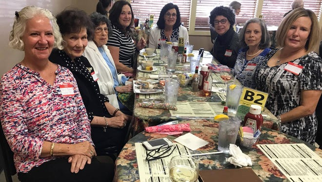 The ladies of the Birthday Club celebrate several October birthdays at The Cottage in Alexandria.