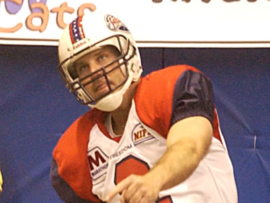 John Diettrich kicks off during a game in the National Indoor Football League