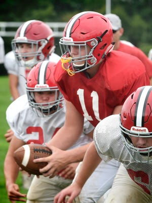 Annville-Cleona quarterback Noah Myers, center, is one of five seniors being counted on to lead a very young Dutchmen team this season.
