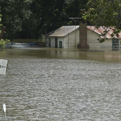 A residence near Bayou Des Cannes in Eunice is partially