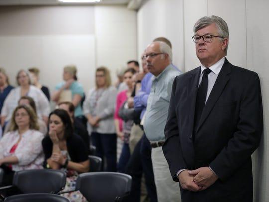 Mayor Tim Hanna looks on as Appleton Police Chief Todd