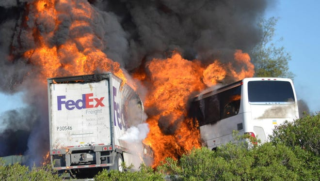 Massive flames engulf a tractor-trailer and a tour bus just after they collide on Interstate 5, near Orland, Calif., on April 10, 2014. Ten people died in the crash.