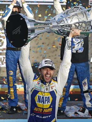 Chase Elliott holds up the NASCAR Cup trophy in Victory Lane on Sunday at Phoenix Raceway in Avondale, Ariz.