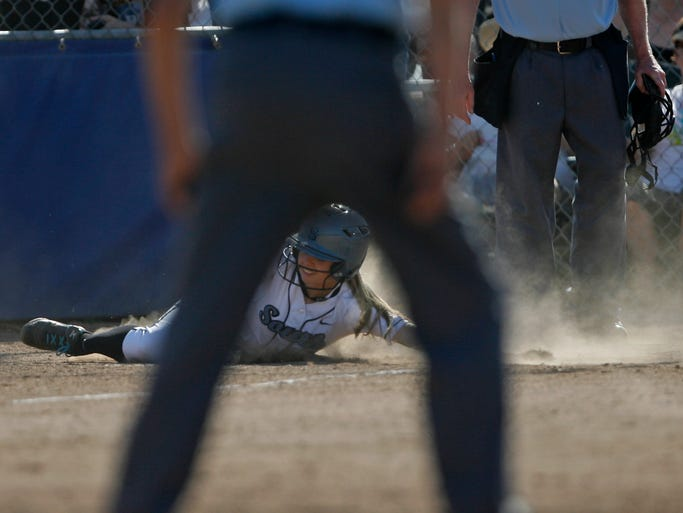 South Salem's Julia Clark slides across home for run in the of the bottom of the first inning during the Saxons' 5-0 victory over Southridge in the quarterfinals of the OSAA 6A softball playoffs, at South Salem, on Friday, May 30, 2014.