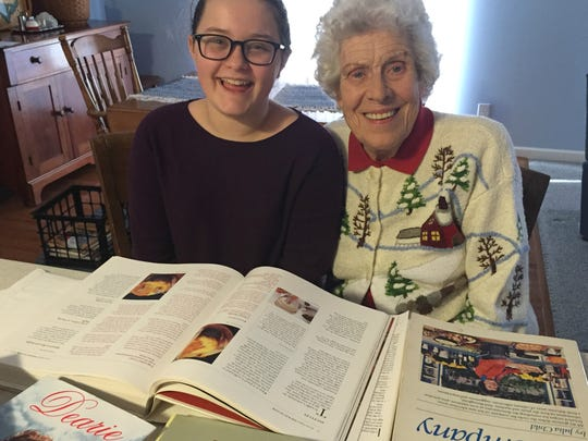 "Sabrina Richard, 11, and Athalin Parmenter, 93, look one last time through Parmenter's Julia Child collection, now in Richard's care. ""Don't worry,"" Richard tells Parmenter, ""I won't sell them for 35 cents at a yard sale."""