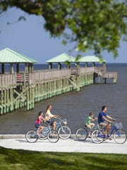 A family of bicyclists enjoys a ride along the 15.5-mile-long Live Oaks Bicycle Route connecting Ocean Springs with Gulf Island National Seashore.
