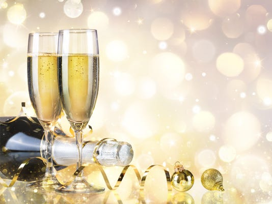 toast with bottle and champagne golden background