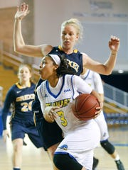 Delaware guard Erika Brown pushes past Drexel's Jackie Schluth in the first period at the Bob Carpenter Center Friday.