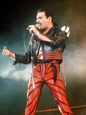 Singer Freddie Mercury of the rock group Queen performs at a 1985 concert in Sydney, Australia.