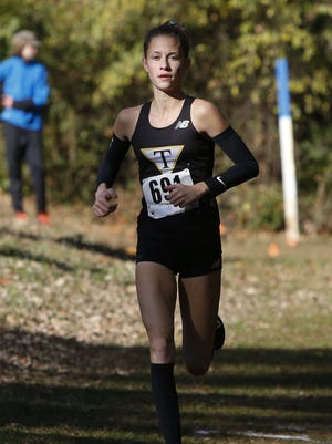 Tatnall's Keelin Hays leads the DIAA Division II girls cross country state championship before winning the event by 7 seconds Saturday at Brandywine Creek State Park.