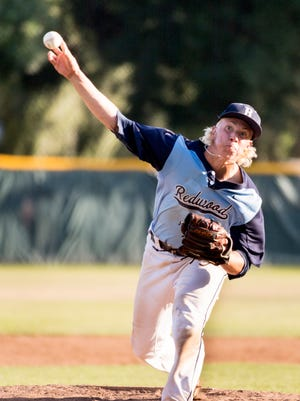 Redwood's Hunter Bryan pitches against Bullard in a Central Section Division I first-round high school playoff game on Tuesday, May 15, 2018.